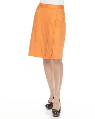 オレンジ ラップ風デザインスカートを見る