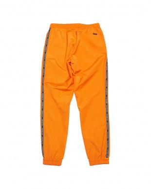 オレンジ EXZ-LOGOTYPE LINE TAPE TRACKSUIT PANTS ロゴサイドテープ イージーパンツを見る