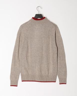 ベージュ ハイネックセーターを見る
